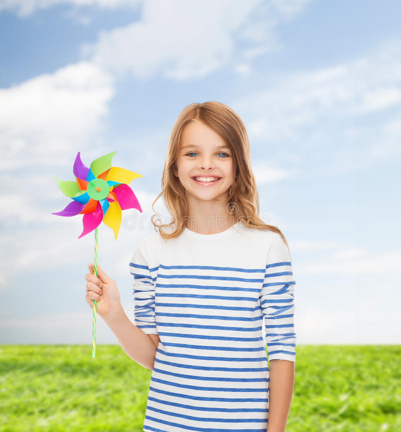 Free Smiling Child With Colorful Windmill Toy Royalty Free Stock Images - 39630809