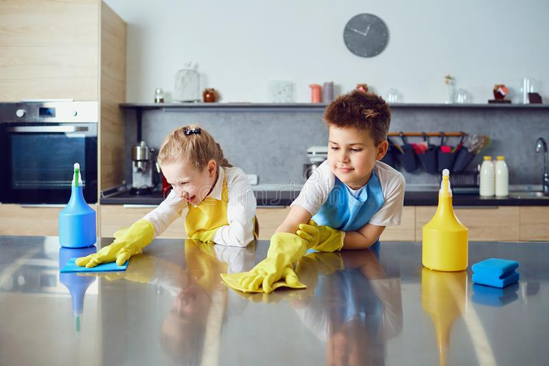 Smiling Children Do The Cleaning In The Kitchen Stock ...