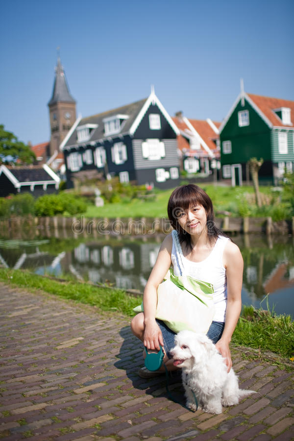 Download Smiling Chinese Girl With Dog Stock Photo - Image of chinese, cute: 9368050