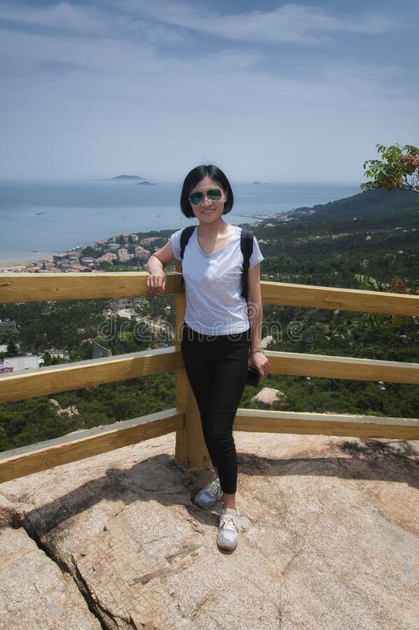 A happy chinese woman with East China Sea background stock photos