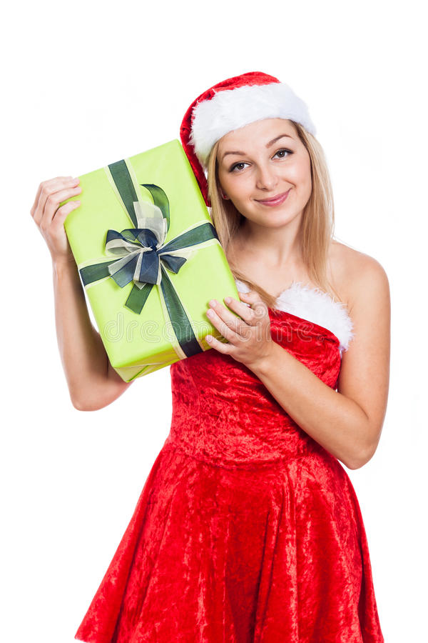 Smiling Christmas woman with present royalty free stock photo