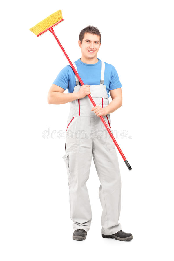 Download Smiling Cleaner In A Uniform With A Broom Stock Photo - Image: 29559654