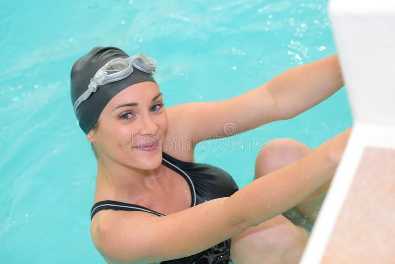 Smiling close up portrait woman professional swimmer. Smiling close up portrait of woman professional swimmer royalty free stock photography