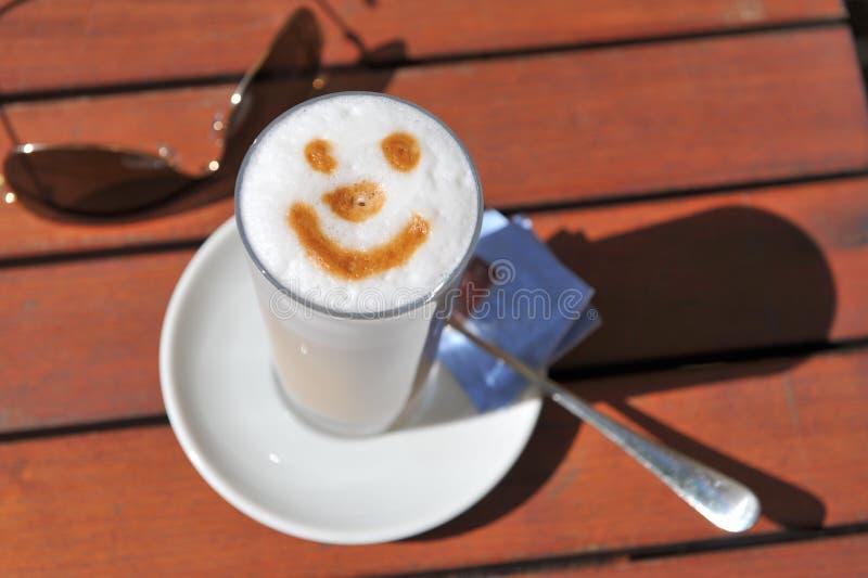 Smiling coffee stock image