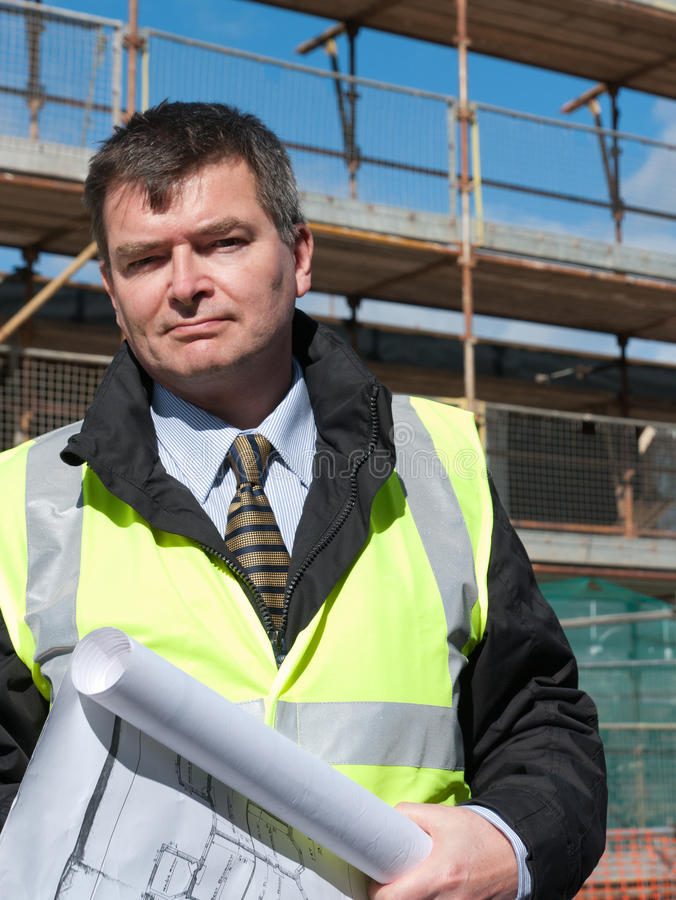 Smiling, confident architect looks at camera royalty free stock photos