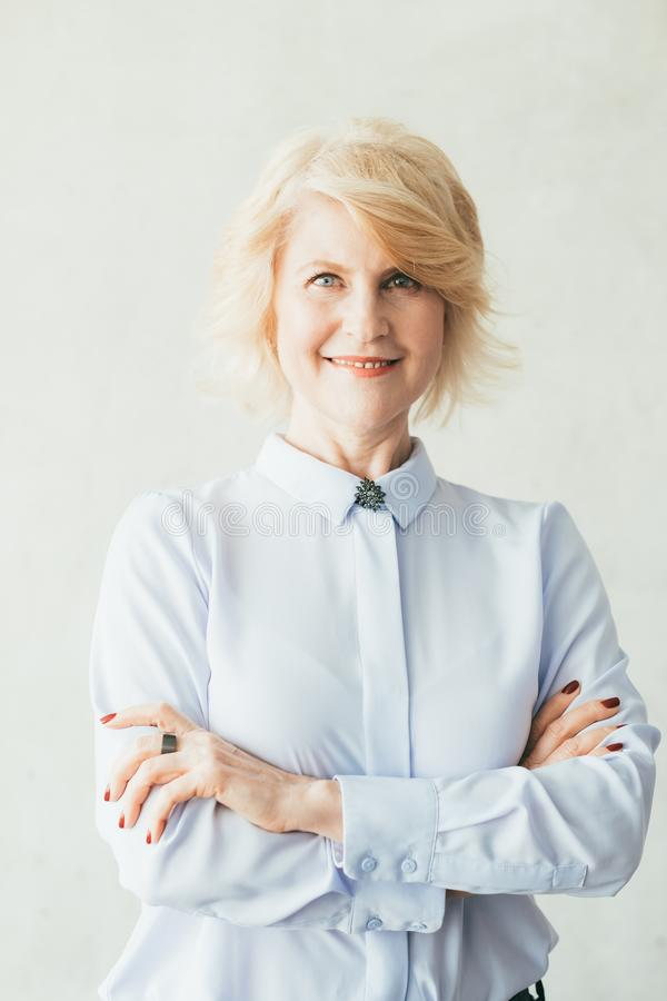 Smiling confident business female arms folded ceo royalty free stock photography