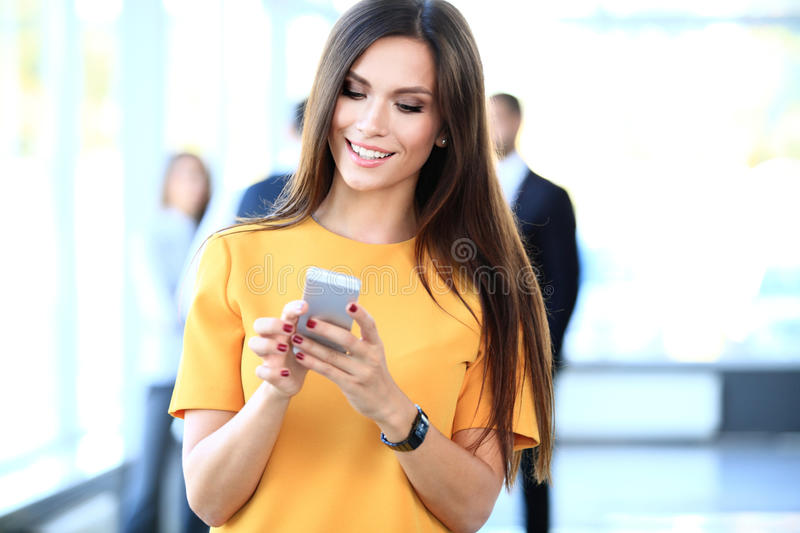 Download Smiling Confident Business Woman Having A Phone Call Stock Photo - Image: 62414356