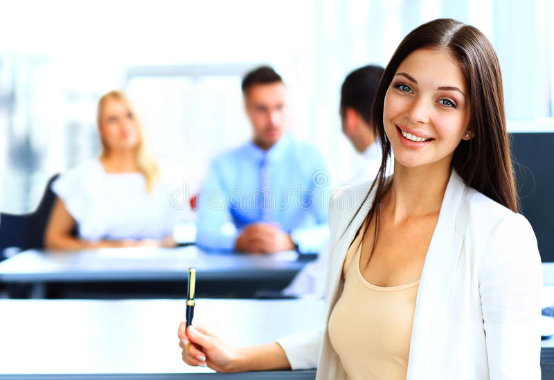 Smiling confident business woman stock images