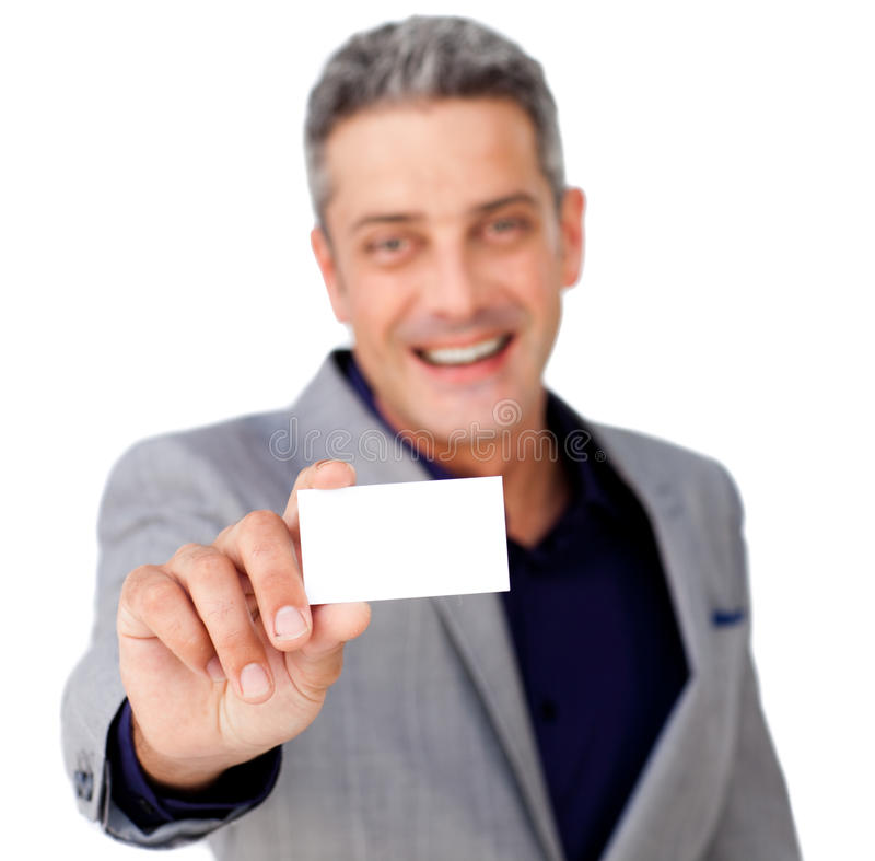 Smiling confident businessman holding a white card