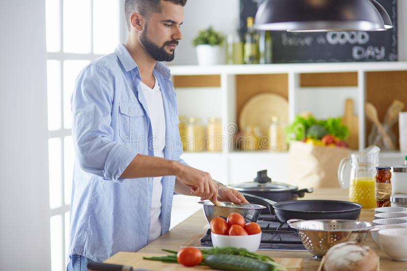 Smiling and confident chef standing in large kitchen royalty free stock photography