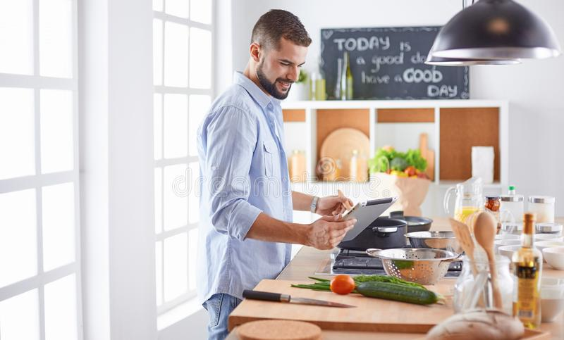 Smiling and confident chef standing in large kitchen.  stock images