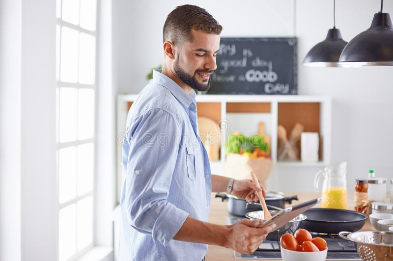 Smiling and confident chef standing in large kitchen.  royalty free stock photo