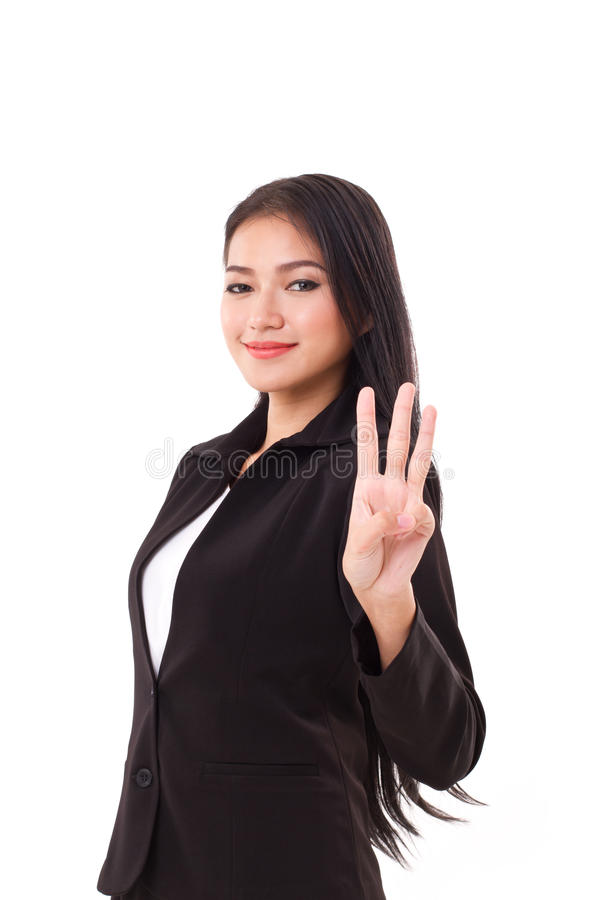 Smiling, confident, successful business woman executive showing 3 fingers. Smiling, confident, successful business woman executive showing, pointing up 3 fingers stock photos