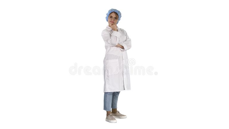 Smiling confident young woman doctor standing with arms crossed over on white background. stock photos
