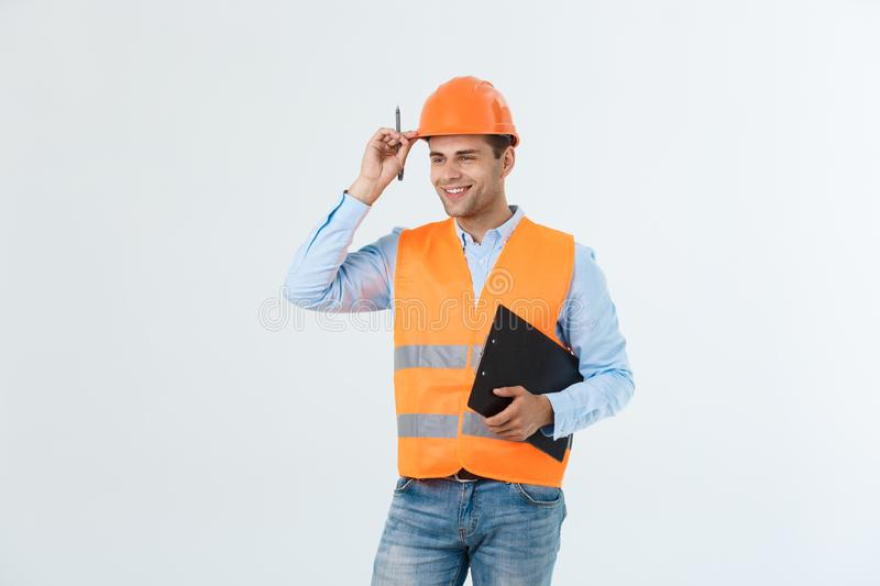 Smiling construction engineer posing isolated over grey background stock photos