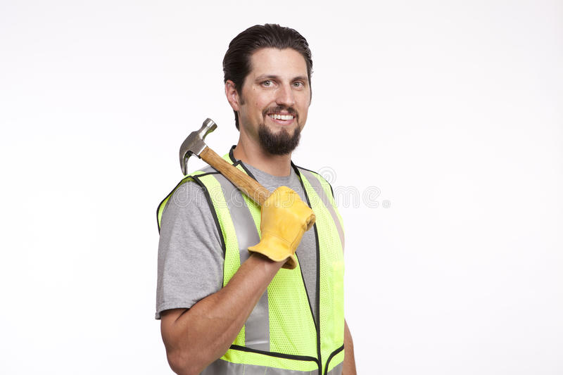 Smiling construction posing with a hammer against white royalty free stock photo