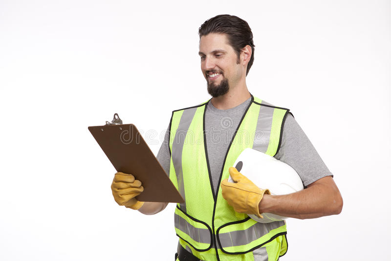 Smiling construction worker going through reports stock photo