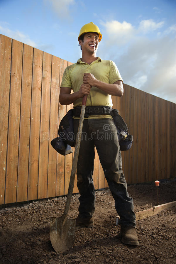 Smiling Construction Worker with a Shovel royalty free stock photography