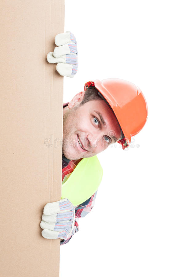 Smiling construction worker standing behind banner royalty free stock images