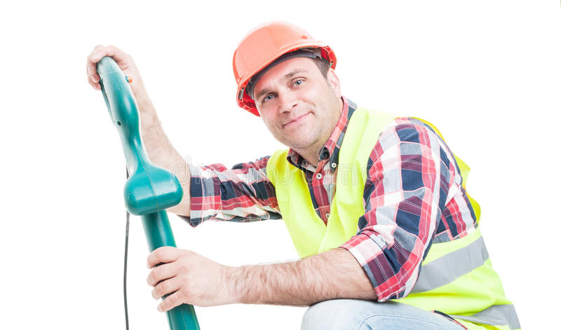 Smiling constructor checking trimming machine stock image