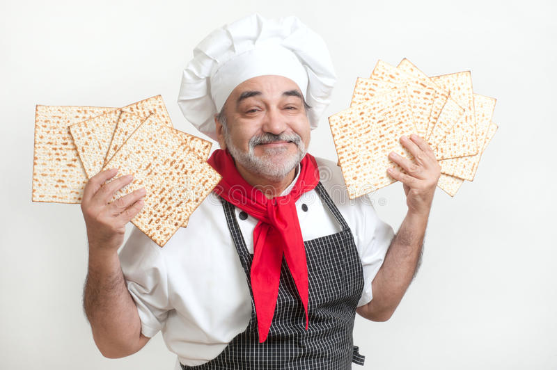 Smiling cook with matza. Passover bread stock image