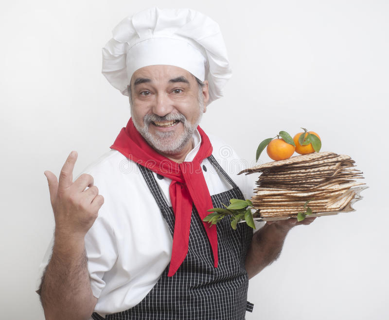 Smiling cook with matza. Passover bread royalty free stock photo