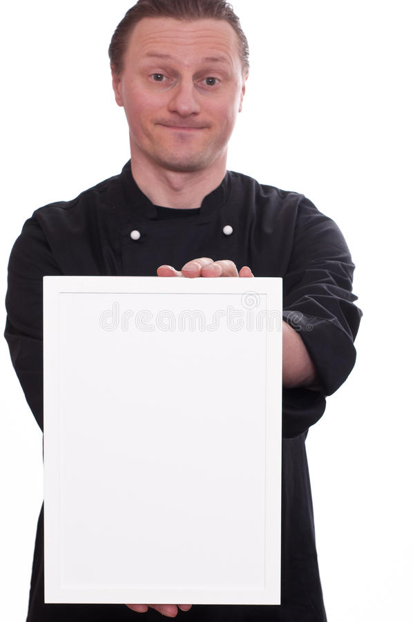 Smiling cook is showing a blank frame. A smiling cook is showing a white blank picture frame stock images