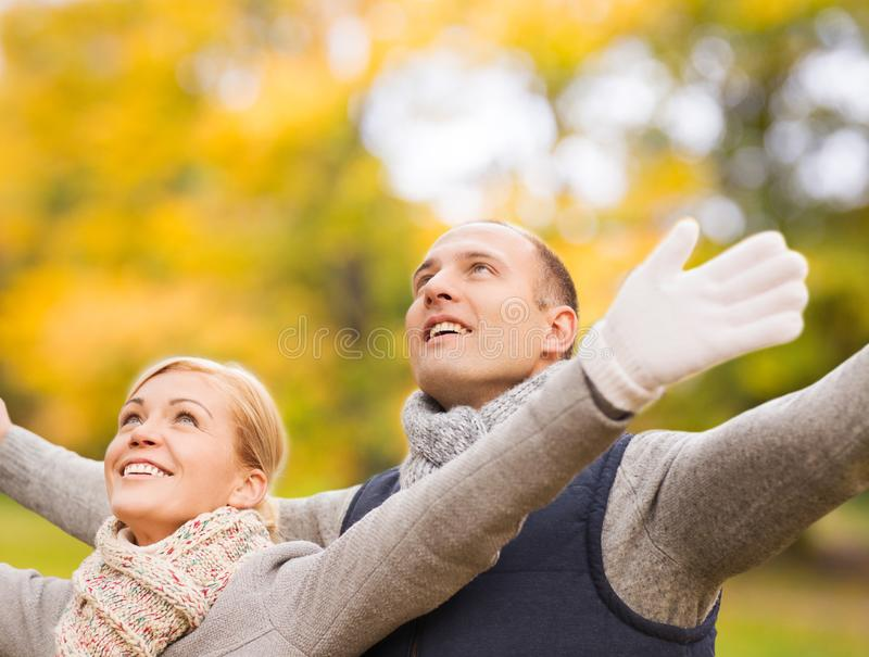 Smiling couple in autumn park stock image