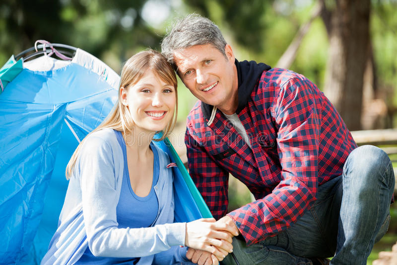 Smiling Couple Camping In Park royalty free stock photo