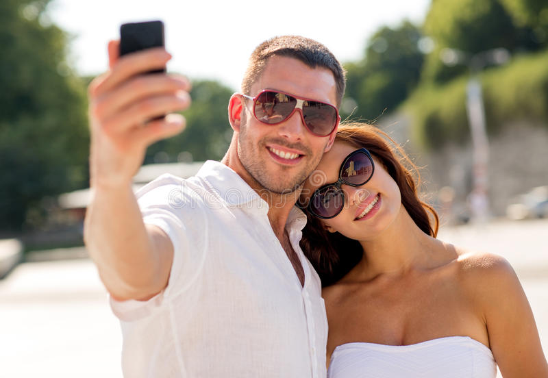 Smiling couple in city stock photos