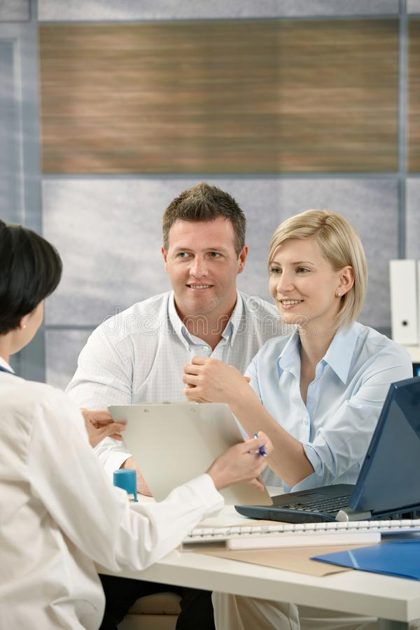 Download Smiling Couple Getting Result From Doctor Stock Image - Image: 21446437