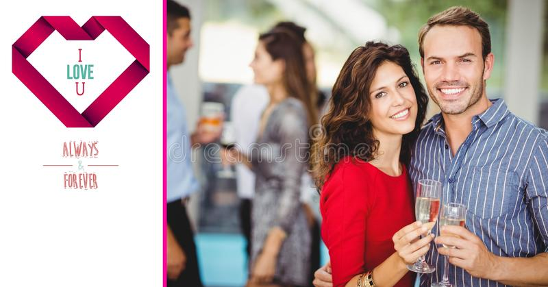 Smiling couple with a glass of champagne on a Valentin card royalty free stock photos
