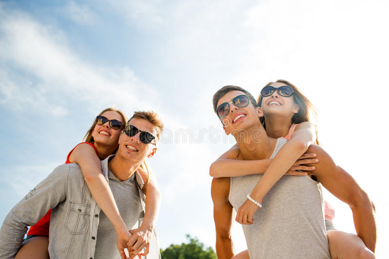 Smiling couple having fun in city. Holidays, vacation, love and friendship concept - smiling couple having fun in city royalty free stock photos