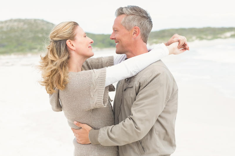 Smiling couple holding one another royalty free stock photo