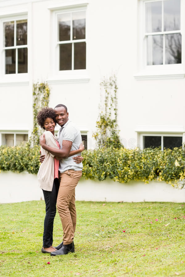 Smiling couple looking back at the camera stock photography