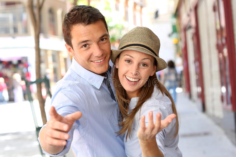 Smiling couple looking at camera royalty free stock photography