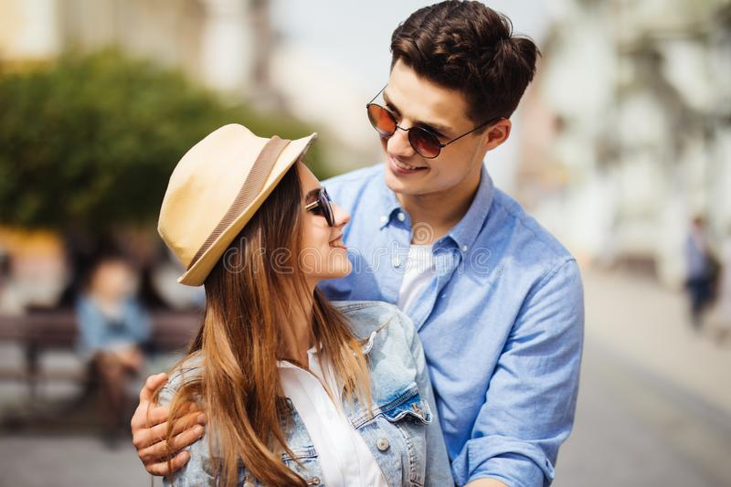 Smiling couple in love outdoors. Young happy couple hugging on the city street. royalty free stock image