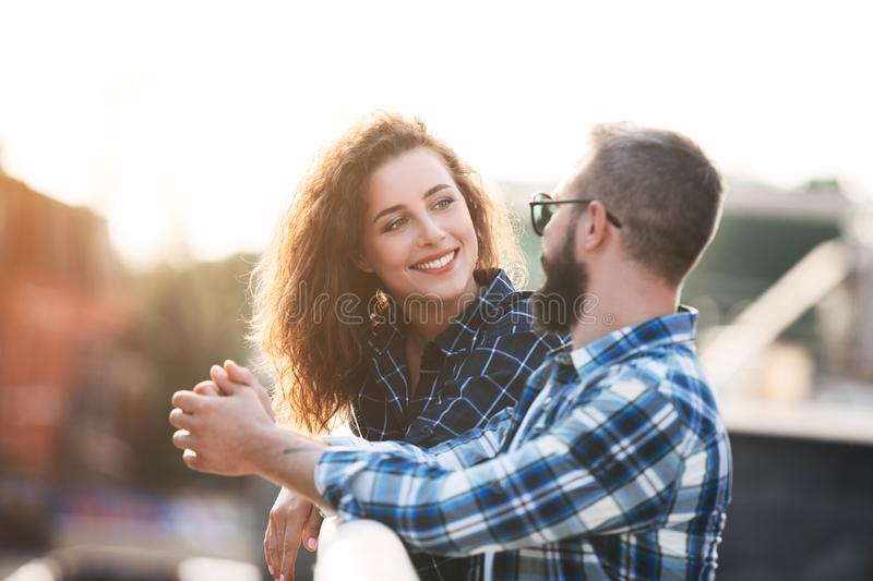 Smiling couple in love, walking and talking outdoors royalty free stock photography