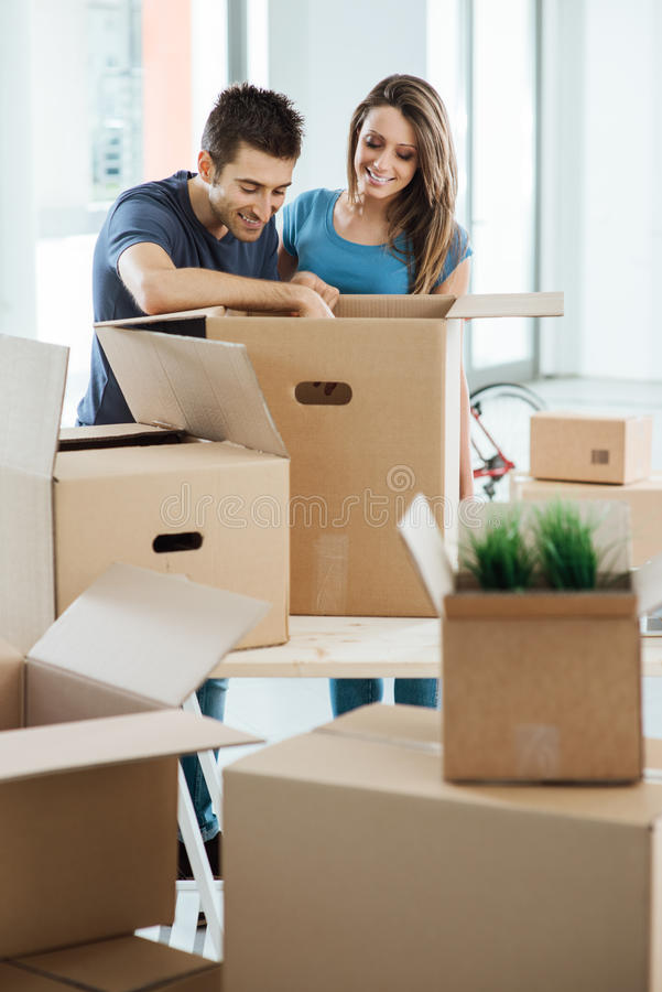 Smiling couple moving in a new house royalty free stock photography