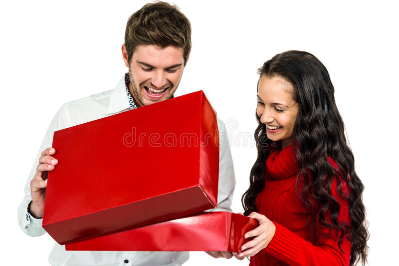 Smiling couple opening gift box royalty free stock images