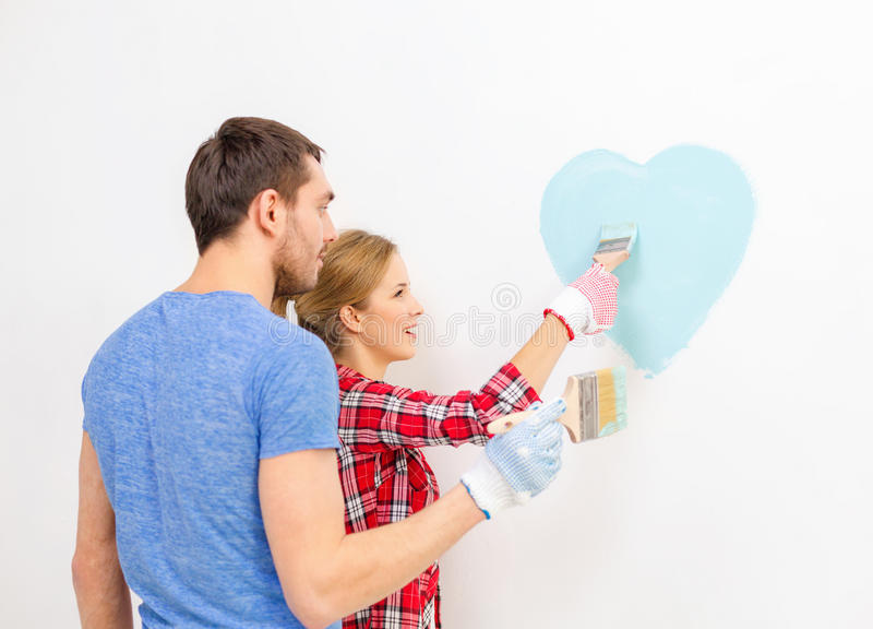 Download Smiling Couple Painting Small Heart On Wall Stock Image - Image: 40042333