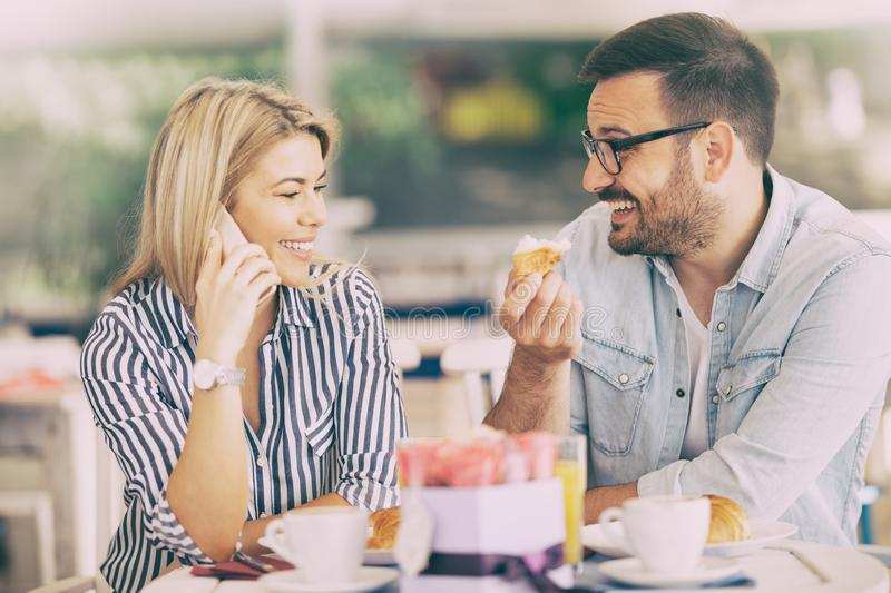 Smiling couple is positively cheerful because of the long-awaited call stock photos