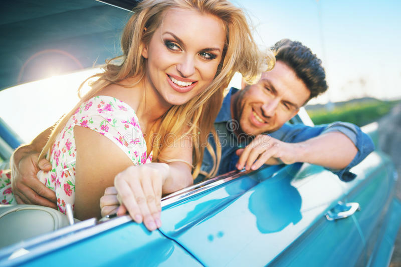 Download Smiling Couple Resting In The Retro Car Stock Photo - Image: 39998828