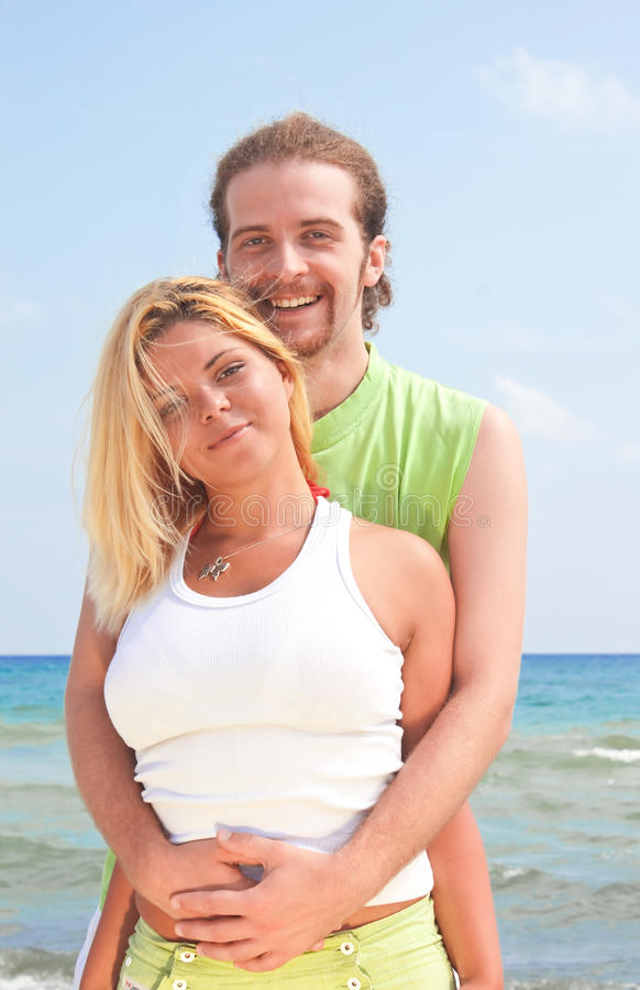 Smiling couple by the sea stock image