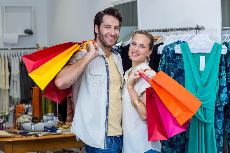 Smiling couple with shopping bags stock photo