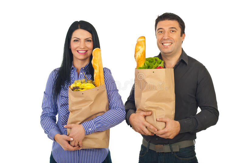 Smiling couple shopping groceries stock photos