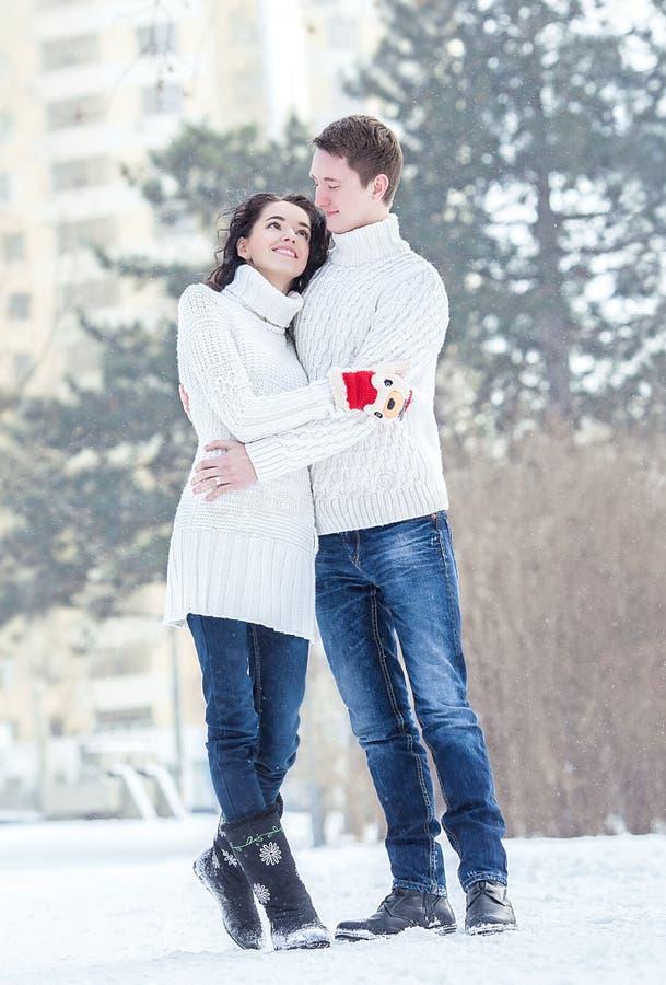 Smiling couple on the snow stock photos
