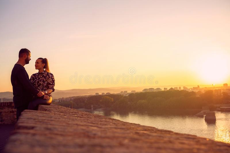 Smiling couple spend time together at sunset royalty free stock photos