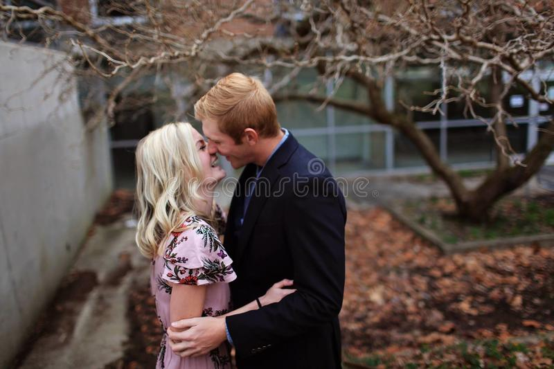 Smiling Couple Standing Near Bare Tree Outdoors Macro Shot royalty free stock photography