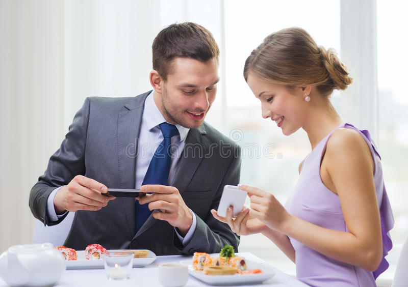 Download Smiling Couple With Sushi And Smartphones Stock Image - Image of picture, happy: 40042583